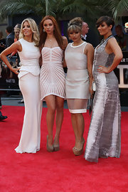 Frankie Sandford opted for this silver disc-print dress for her glamorous red carpet look.