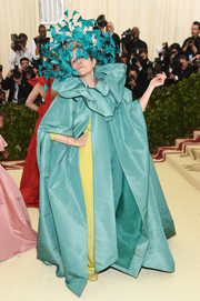 Frances McDormand unleashed her inner diva in a tiffany-blue Valentino Couture opera coat with a ruffled collar at the 2018 Met Gala.