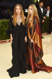 Mary-Kate Olsen was bohemian-glam, as always, in a loose black off-the-shoulder gown by The Row at the 2018 Met Gala.