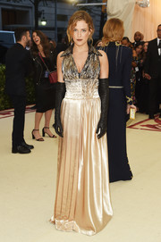 Riley Keough chose a sleeveless, collared satin gown by Louis Vuitton for the 2018 Met Gala.