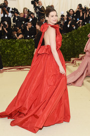 Anne Hathaway dolled up in a voluminous red halter gown by Valentino Couture for the 2018 Met Gala.