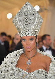 Rihanna nailed the Catholic theme with this heavily embellished miter by Maison Margiela at the 2018 Met Gala.