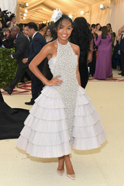 Yara Shahidi got frilled up in a Chanel halter dress with ruffled sides for the 2018 Met Gala.
