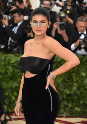 Kylie Jenner attended the 2018 Met Gala wearing silver bracelets on both wrists.
