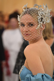 Diane Kruger looked flamboyant wearing this veiled headpiece by Philip Treacy at the 2018 Met Gala.