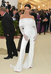 Kendall Jenner opted for an off-the-shoulder jumpsuit by Off-White c/o Virgil Abloh for her 2018 Met Gala look.
