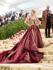 Blake Lively cut an opulent figure in a beaded and embroidered princess gown by Atelier Versace at the 2018 Met Gala.
