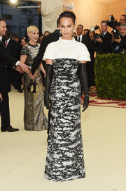 Alicia Vikander was edgy-glam in a capelet-detailed monochrome sequin gown by Louis Vuitton at the 2018 Met Gala.