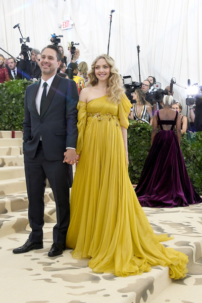 More Pics of Amanda Seyfried Long Wavy Cut (1 of 21) - Amanda Seyfried Lookbook - StyleBistro [dress,gown,clothing,shoulder,yellow,event,formal wear,fashion,haute couture,a-line,heavenly bodies: fashion the catholic imagination costume institute gala - arrivals,new york city,metropolitan museum of art,actors,amanda seyfried,thomas sadoski]