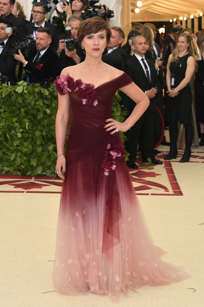 Scarlett Johansson channeled her inner fairy princess in a flower-appliqued ombre off-the-shoulder gown by Marchesa at the 2018 Met Gala.