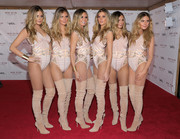 Heidi Klum's costume during her Halloween party--a studded nude bodysuit--seemed normal enough for the supermodel. What made it extraordinary were the five clones (dressed in the exact same outfit) she brought along!
