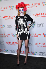 Heather Graham donned a skeleton dress for her La Catrina look during Heidi Klum's Halloween party.
