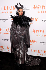 Halima Aden attended Heidi Klum's Halloween party dressed as Maleficent in a gunmetal gown with voluminous sleeves.