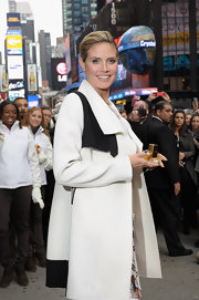 Heidi Klum wore her hair pulled back in a sleek updo while promoting her fragrance in NYC.