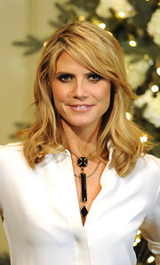 Heidi Klum wore her hair in layered waves while attending a QVC event.