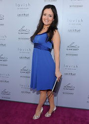 Danica flattered her preggers figure with a empire waist cocktail dress and sported metallic evening sandals with a matching clutch.