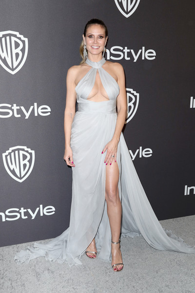 Heidi Klum Cutout Dress [dress,clothing,shoulder,gown,fashion model,hairstyle,beauty,joint,fashion,carpet,heidi klum,beverly hills,california,the beverly hilton hotel,instyle,golden globes,warner bros.,arrivals,party]
