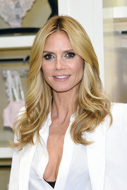 Heidi Klum was perfectly coiffed with feathery, center-parted waves at the launch of her lingerie collection.