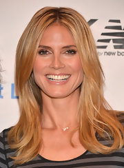 Heidi Klum opted for a super minimal makeup look when she donned subtle nude lip gloss.