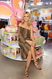 Heidi Klum paired a wild animal print one-shoulder dress with even more eye-catching strappy studded stilettos.