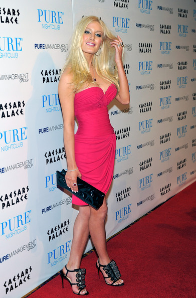 """Heidi's lustworthy black satin and lace """"Fortitia"""" heels complete her hot pink look."""