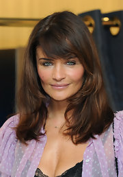 Helena Christensen attended the launch for a collection of Triumph Essence lingerie wearing her hair in tousled layers with long side-swept bangs.
