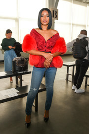 Keke Palmer went for luxurious styling with a red fur stole.