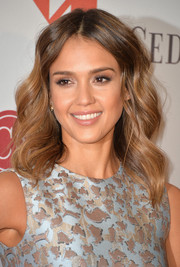Jessica Alba chose a cute wavy hairstyle for The Helping Hand of LA Mother's Day Luncheon.