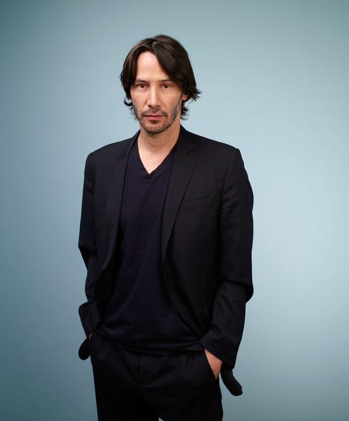 Keanu wore his hair at medium length, with a center-part.