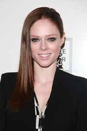 Coco Rocha wore her long sleek tresses swept over one shoulder at the Herve Leger by Max Azria fall 2012 fashion show.