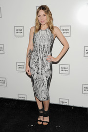 Skylar Grey paired her dress with black sandals featuring wide ankle straps.