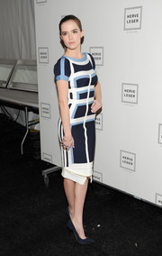 Zoey Deutch looked enviably slim in a tricolor bandage dress during the Herve Leger fashion show.