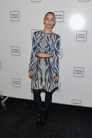 Cara Santana looked fashion-forward in a long-sleeve, patterned crop-top during the Herve Leger fashion show.