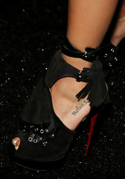 Jessica showed off her sky high ankle strap heels while hitting the Herve Leger fashion show.