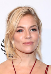 Sienna Miller worked a sexy loose updo at the Tribeca Film Fest premiere of 'High-Rise.'