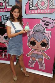 "Hilaria Baldwin was casual and youthful in a frayed denim skirtall at the launch of L.O.L. Surprise! Unboxing Video Booth at Toys ""R"" Us."
