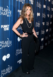 Maria Shriver put her fab figure on display in a tight black jumpsuit during Hilarity for Charity's variety show.