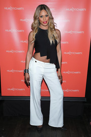 Laverne Cox channeled her inner hippie in an asymmetrical, carwash-hem crop-top while attending Hilarity for Charity.