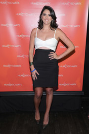 Cecily Strong flashed some cleavage and abs in a black-and-white cutout dress while attending Hilarity for Charity.