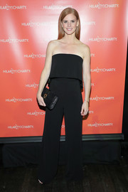 Sarah Rafferty went for casual sophistication in a strapless black jumpsuit with a foldover neckline when she attended Hilarity for Charity.