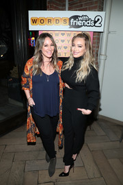 Haylie Duff donned a floral duster for a dressier finish to her look.