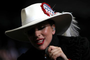 Lady Gaga accessorized with an embellished white cowboy hat by Gladys Tamez for a Hillary Clinton campaign rally.