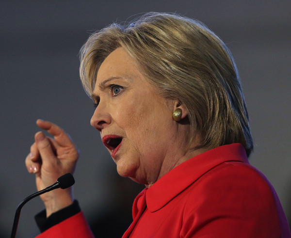 Hillary Clinton Side Parted Straight Cut [microphone,spokesperson,chin,cheek,gesture,public speaking,audio equipment,singer,orator,speech,hillary clinton,bernie sanders,voters,clinton,debate,win,sc,hillary clinton holds corridor of opportunity town hall,denmark,democratic]