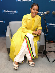 Jada Pinkett Smith cut a bold figure in a fringed canary-yellow coat by Maison Rabih Kayrouz during Hoda Kotb's Leading Ladies event.