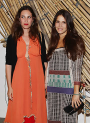 Margherita Missoni paired her vibrant dress with a simple black suede clutch when she attended the Hogan and Big Bambu cocktail party.