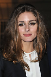 Olivia Palermo attended the Hogan by Karl Lagerfeld 2012 fall presentation wearing soft gray and khaki shades of eyeshadow.