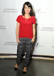 Constance Zimmer styled her blouse with a pair of black-and-white patterned pants.