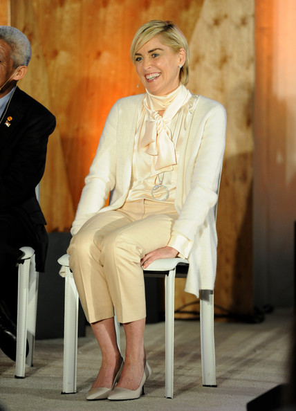 Sharon Stone was demure in a cream-colored cardigan layered over a silk tie-neck blouse during the Q&A with Ann Curry event.