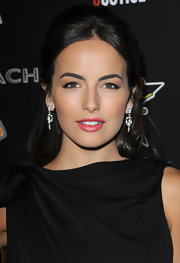 Camilla Belle rounded out her glamorous look with a pair of diamond chandelier earrings by Cartier.