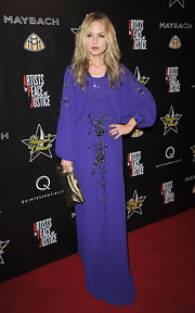 Stylist Rachel Zoe always goes for a boho-chic look, which is what she did on this particular night. She matched her deep purple dress with a metallic clutch.